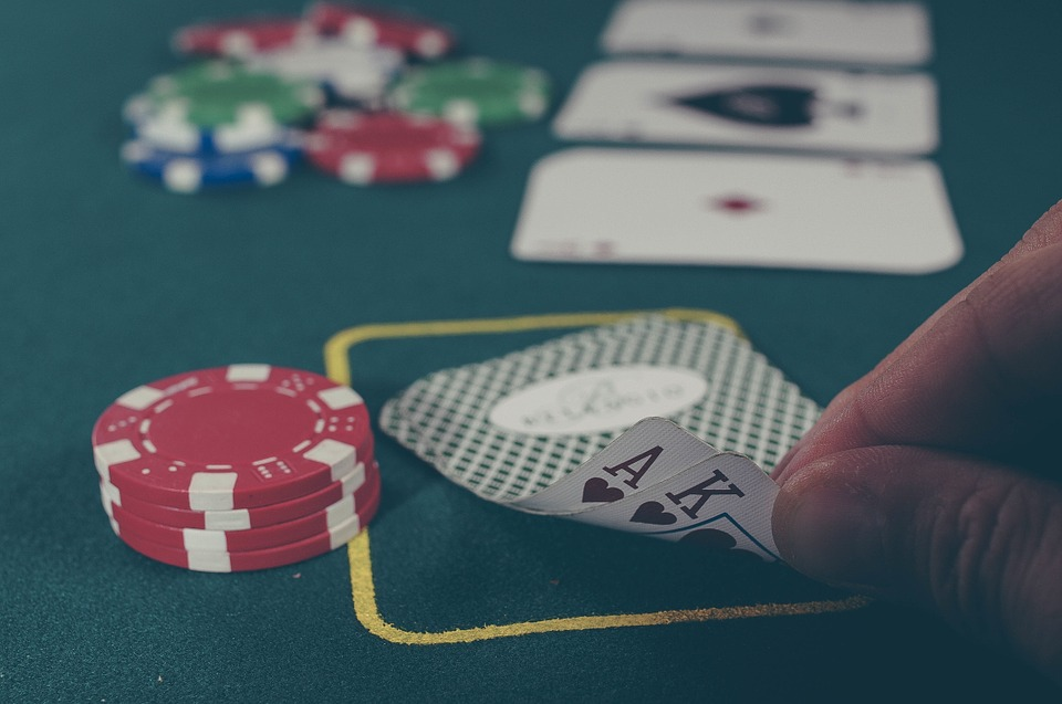 ace and king card with chips on table - Poker101: A Beginner's Guide to Playing Poker Like A Pro