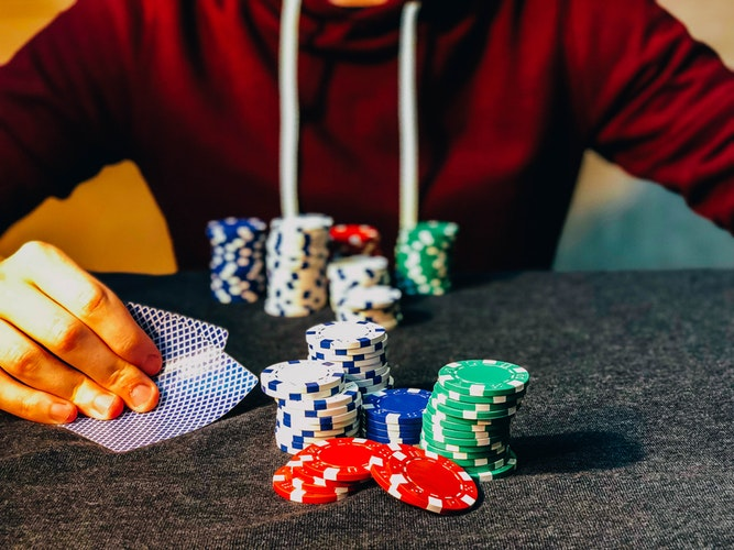 man playing poker with many chips - Poker101: A Beginner's Guide to Playing Poker Like A Pro