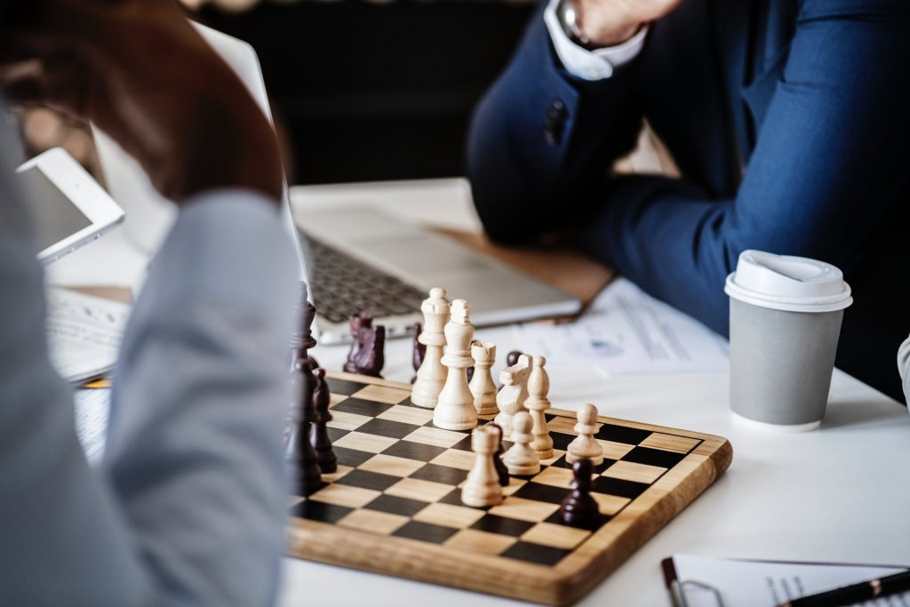 photo of brown wooden chess set on table beside white and gray disposable cup 1024x683 - 8 Reasons Why You Should Start Playing Board Games
