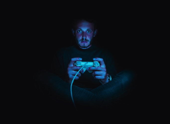 man in dark playin video game - 6 Important Benefits of Playing Video Games You Have to Know About